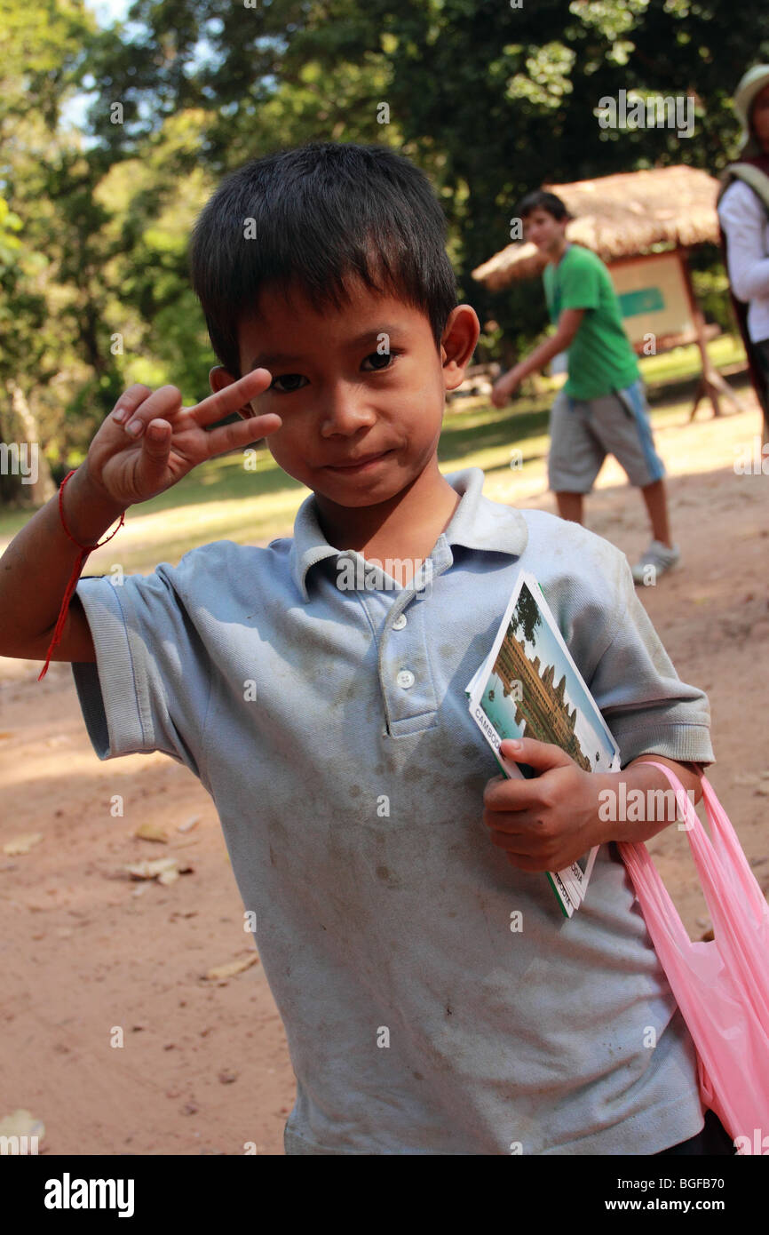Cambodian boy selling postcards outside Angkor Thom - Stock Image