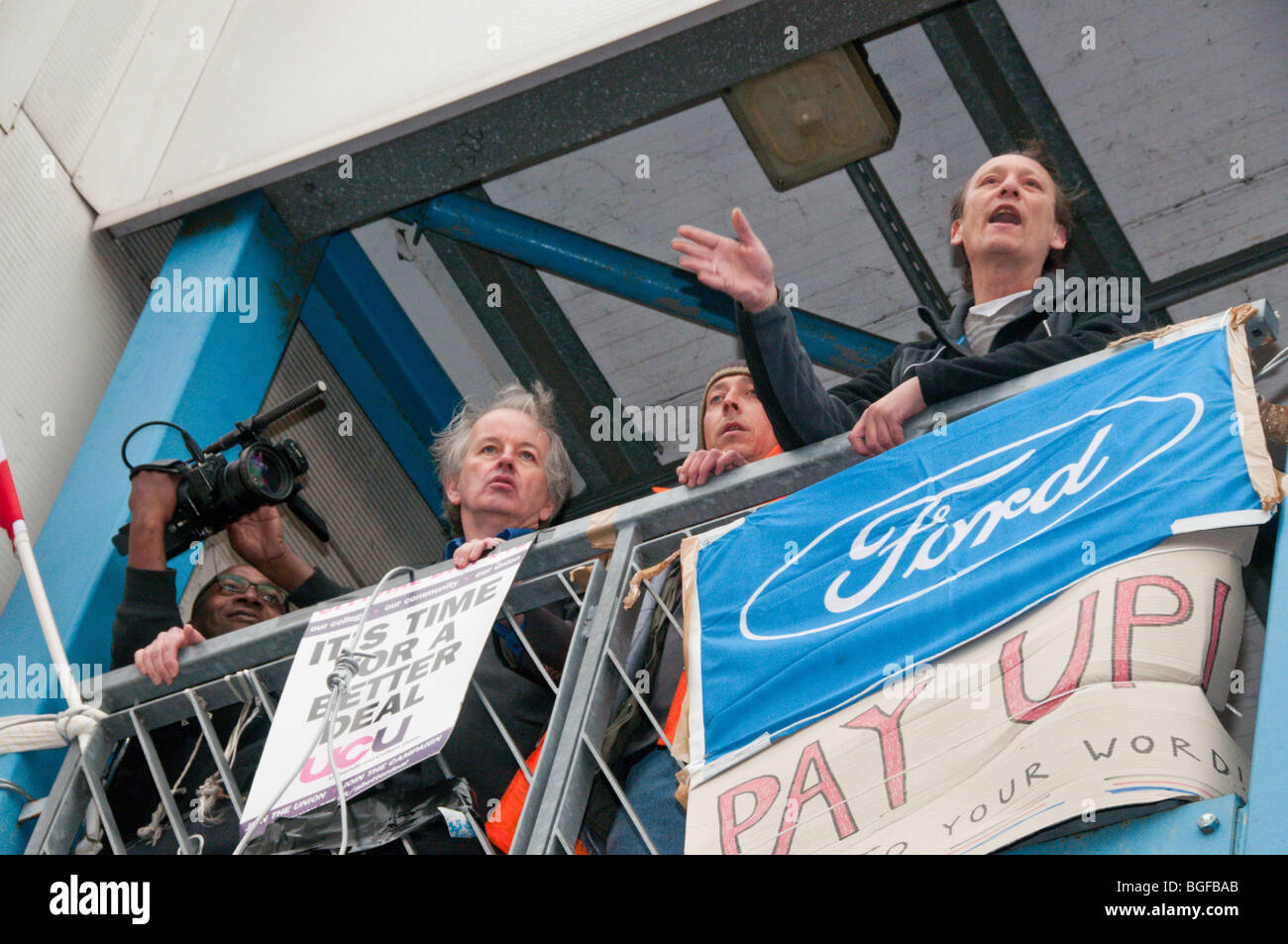 Sacked workers speak from factory balcony as occupation at Visteon (Ford) Enfield is ended by court order. Stock Photo