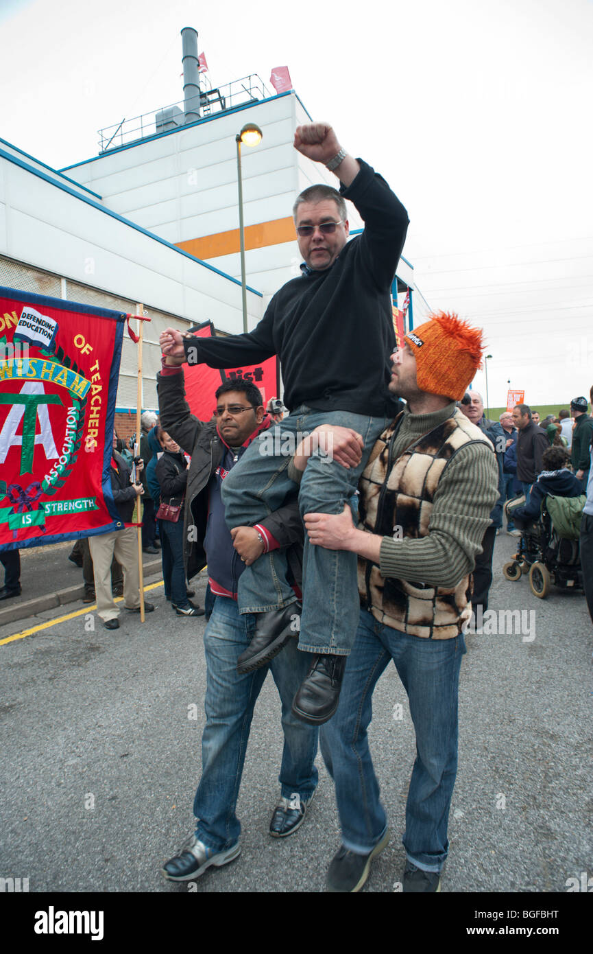 Unite convener Kevin Nolan is chaired by workers as occupation at Visteon (Ford) factory is ended by court order Stock Photo