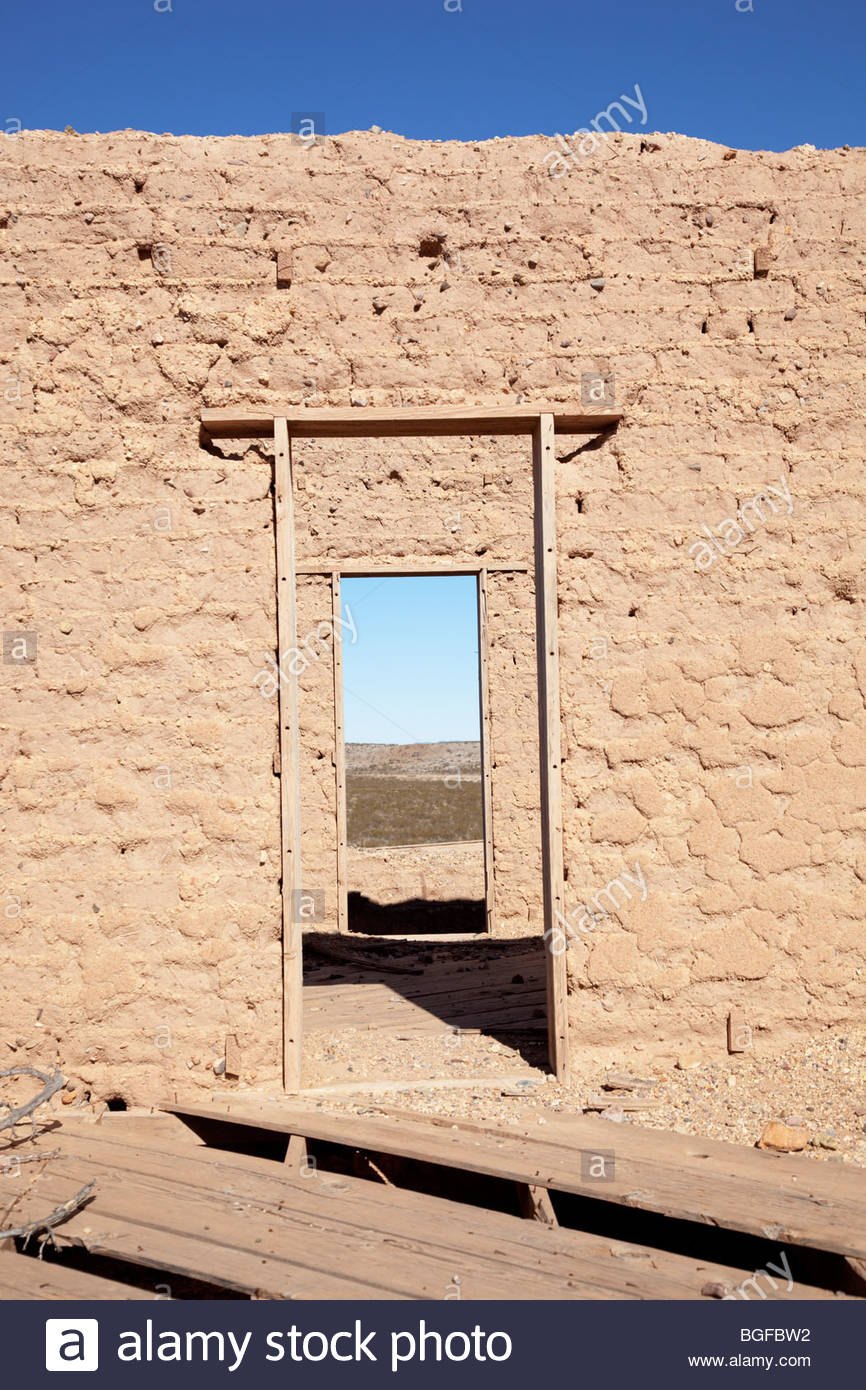 Old door adobe wall ruins wood frame weathered 'New Mexico' - Stock Image