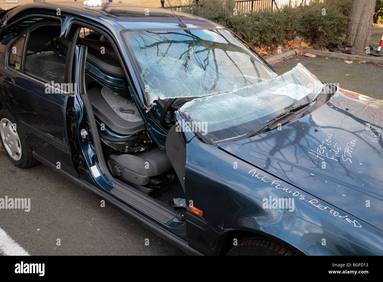 The remains of a car cut open (roof removed) by the London Fire Brigade at a fire safety awareness day in Feltham, - Stock Image