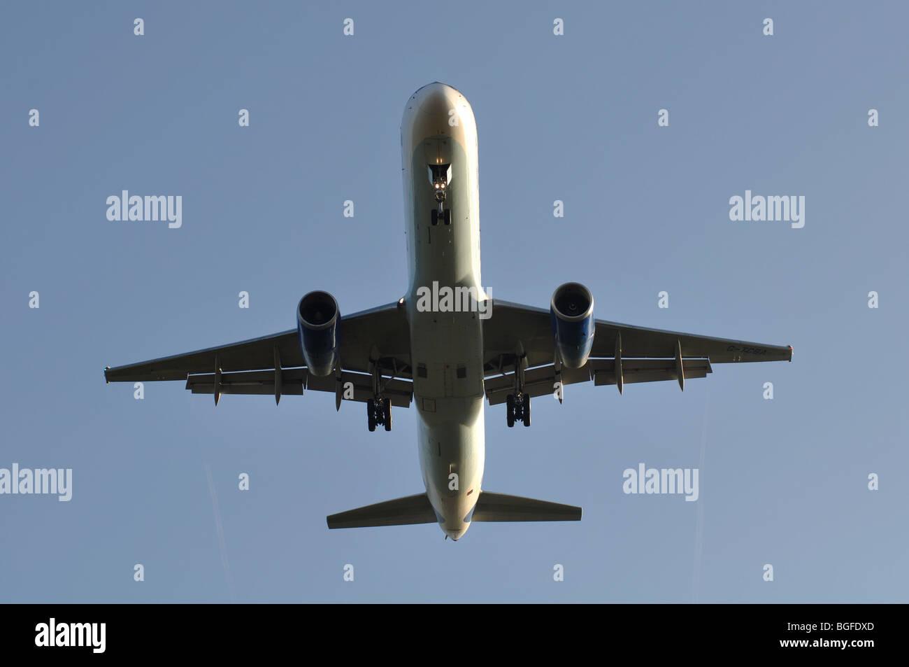 Thomas Cook Boeing 757 aircraft G-TCBA approaching Birmingham International Airport, UK - Stock Image