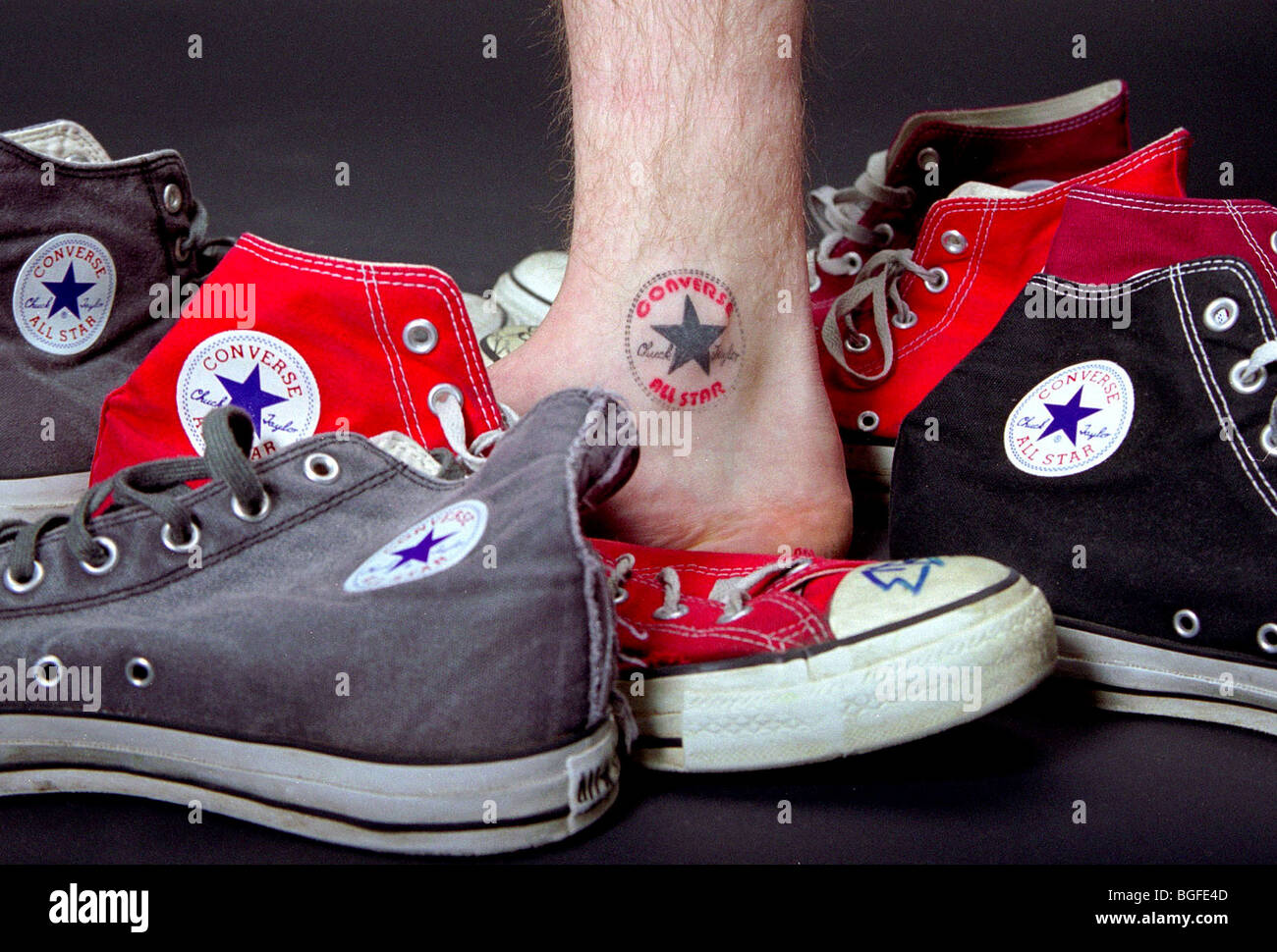 2ede026458ae A still life of Converse shoes and a food with a Converse tattoo. - Stock