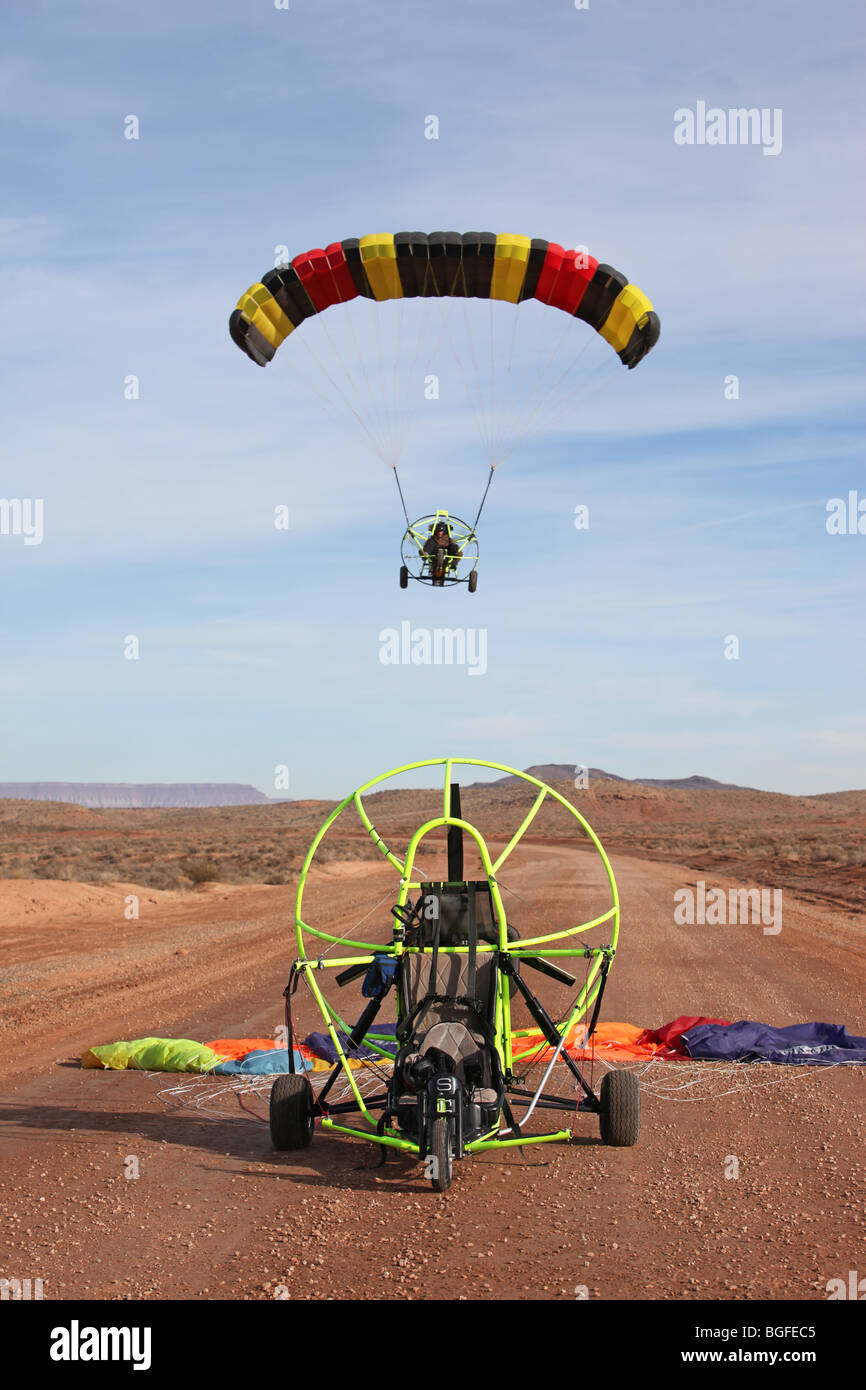 Power Parachute Flying Over Aircraft On Ground In Desert Area Of