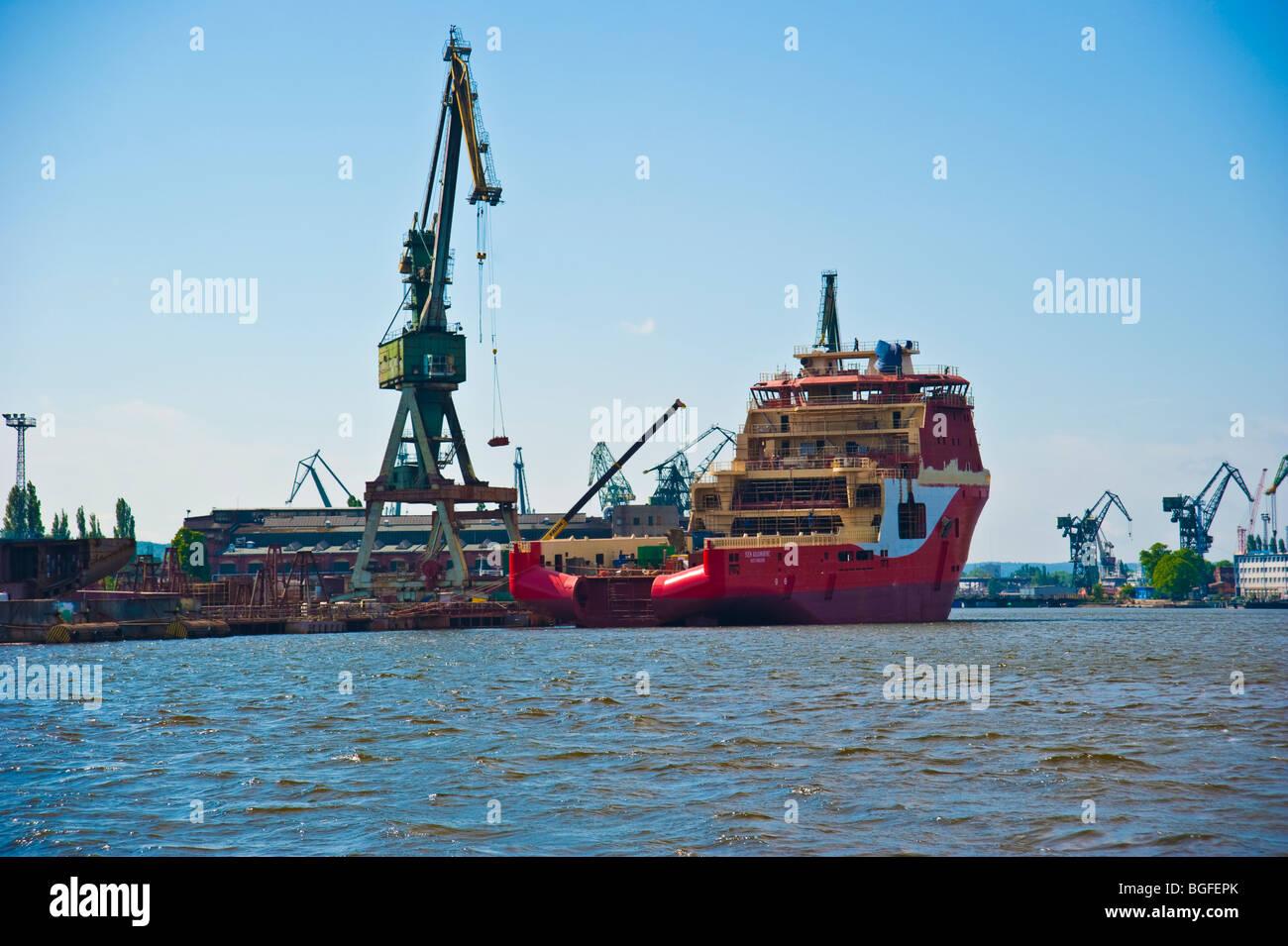 Shipyard with cranes and docks, Gdansk, Poland   Werft Danzig, Polen - Stock Image