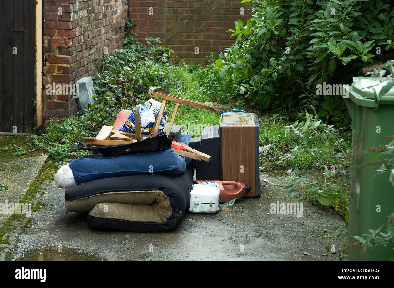 Pile of rubbish left outside a house - Stock Image