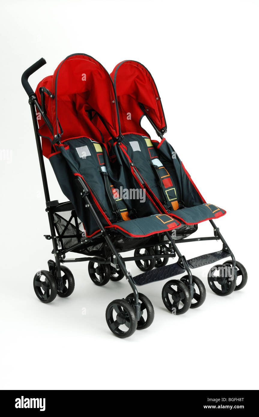 A twin red double baby stroller carriage Stock Photo