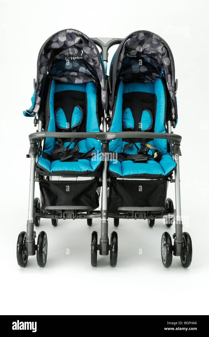 A twin blue double baby stroller carriage - Stock Image