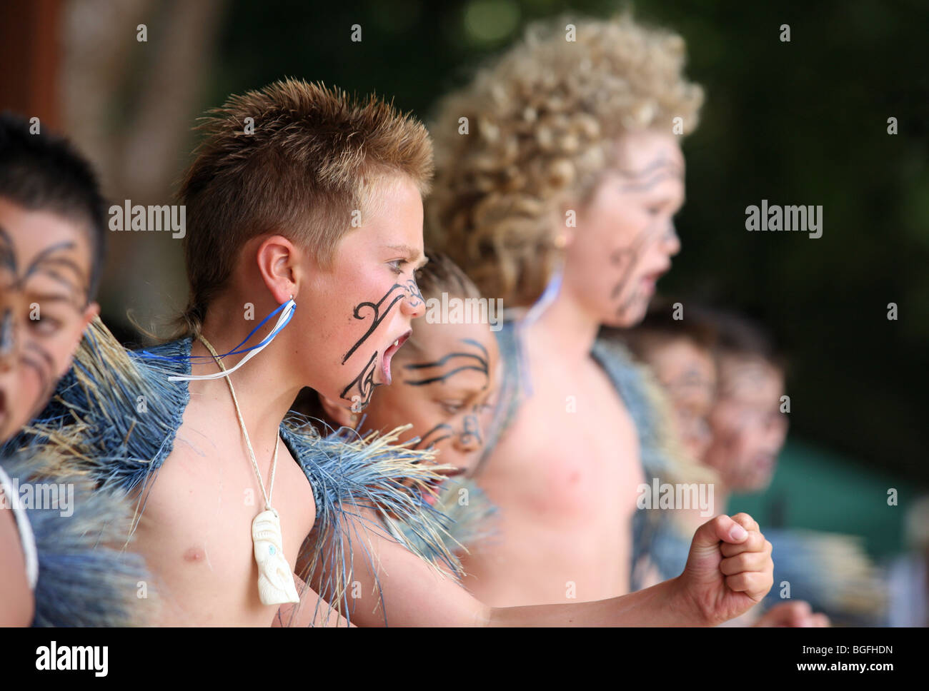 Male members of a Kapa Haka Roopu dancing at Waitangi Day celebrations on the Waitangi Treaty Grounds, Waitangi, New Zealand. Stock Photo