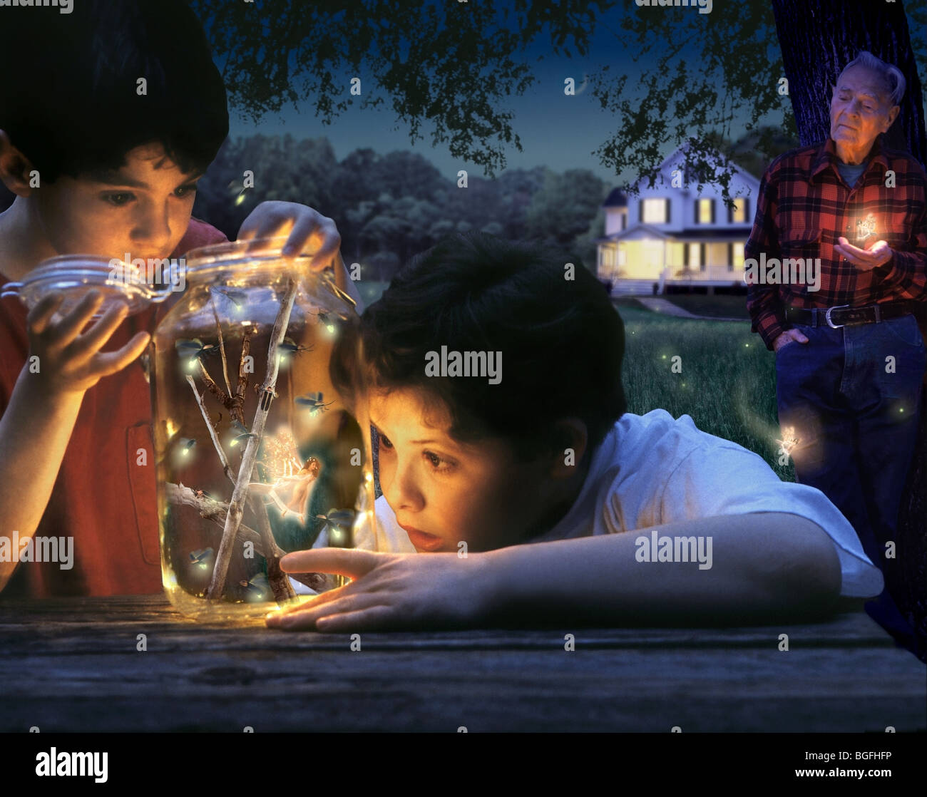 Two boys have collected fireflies but are discovering that they captured something special. - Stock Image