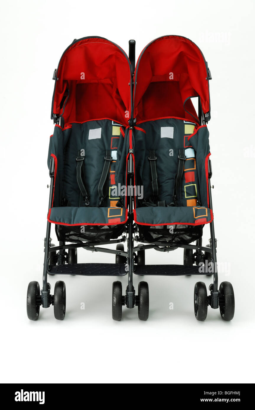 A twin red double baby stroller carriage - Stock Image