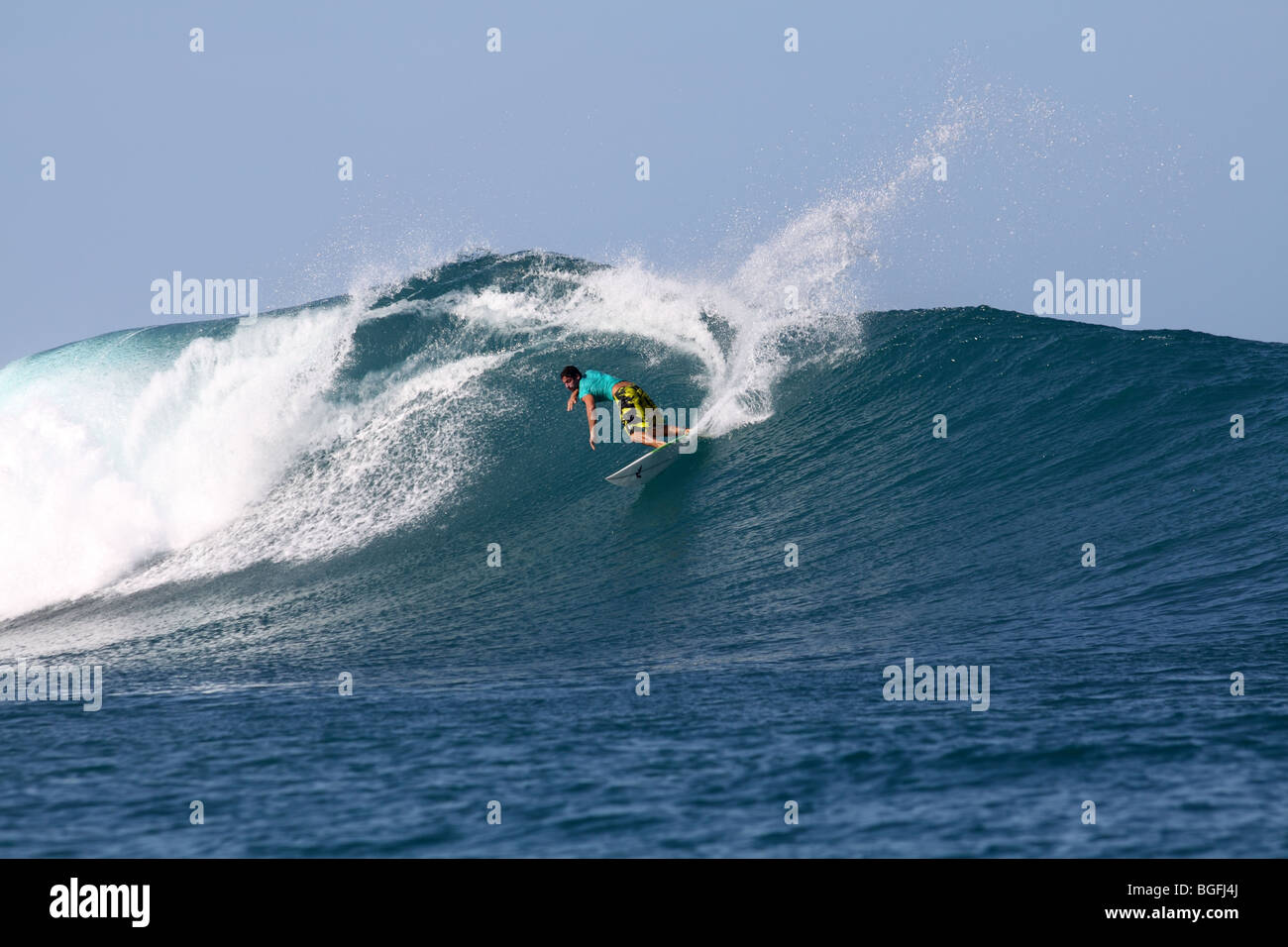 Man surfing in the Mentawai Islands off Sumatra, Indonesia - Stock Image