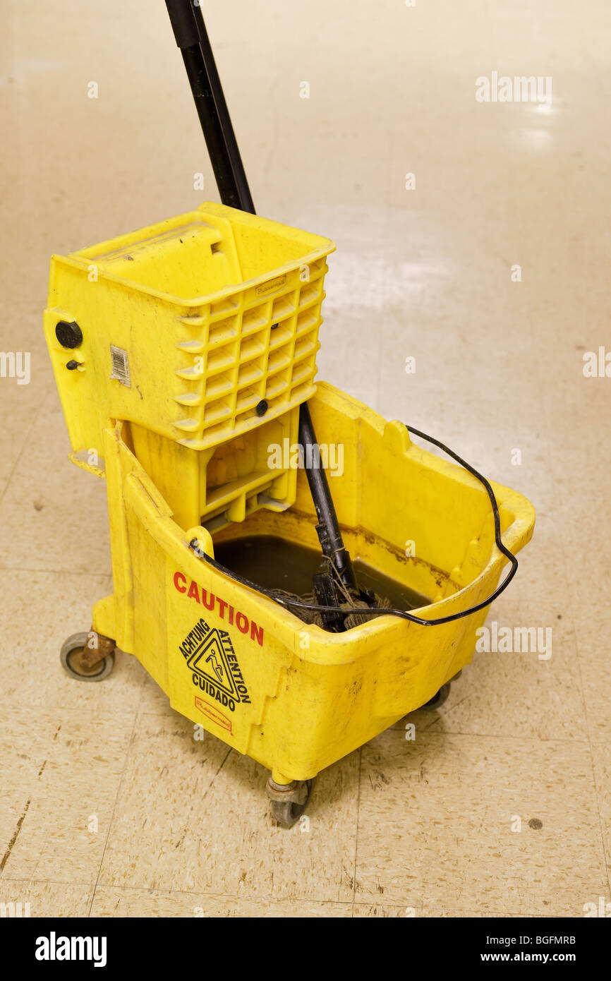 A mop bucket and mop - Stock Image