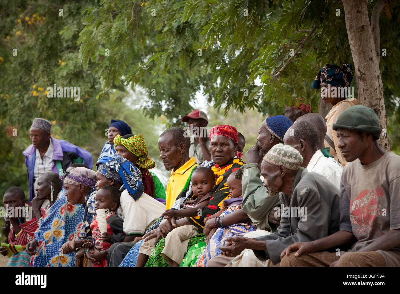 Villagers wait outside a medical dispensary in Tanzania: Manyara Region, Simanjiro District, Kilombero Village. - Stock Image