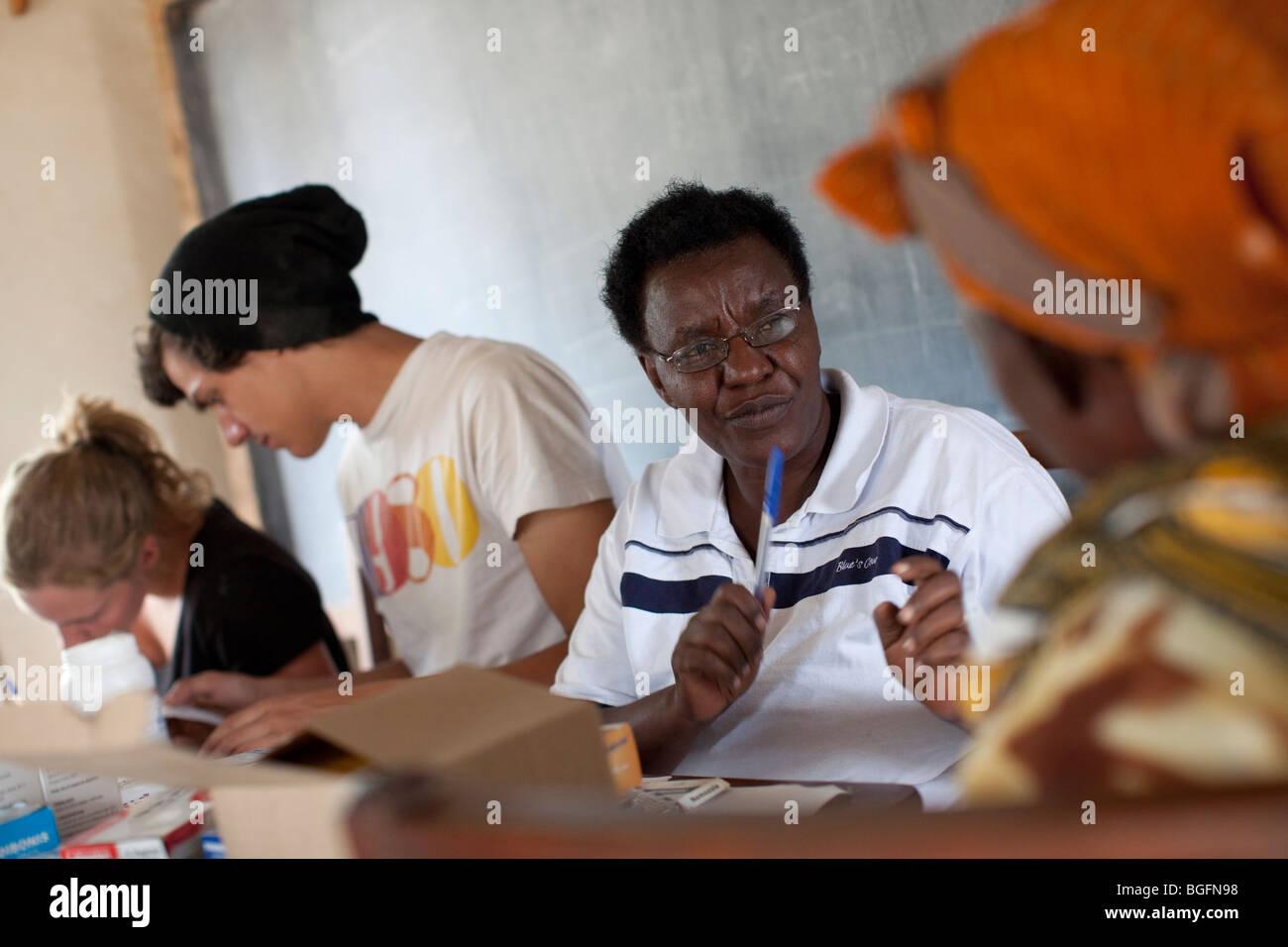 A nurse consults with a patient at a medical dispensary in Tanzania: Manyara Region, Simanjiro District, Kilombero Stock Photo