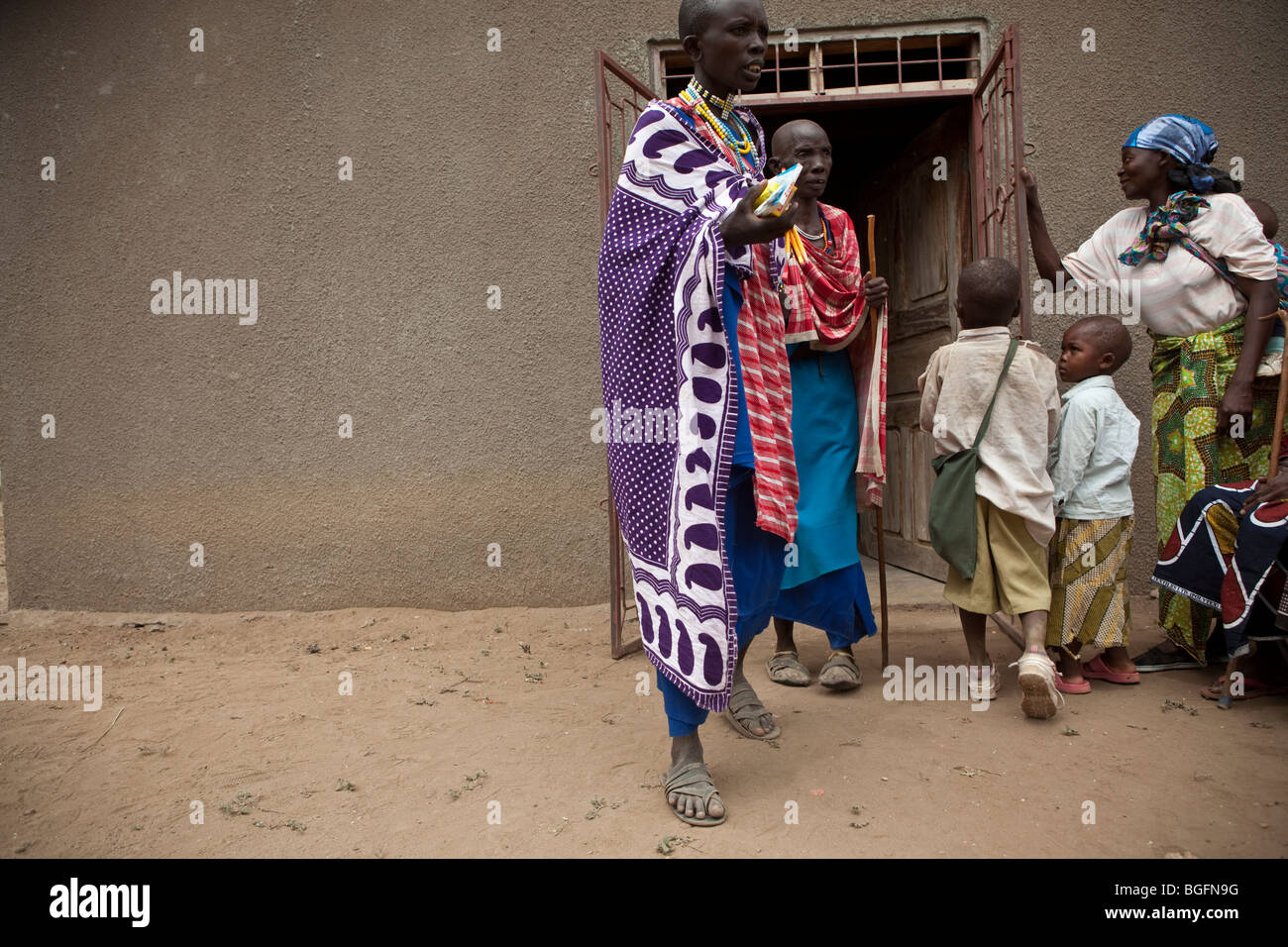 Maasai women exit a medical dispensary in Tanzania: Manyara Region, Simanjiro District, Kilombero Village. - Stock Image