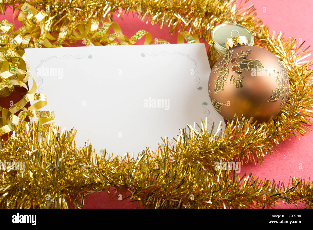 blank Christmas card with gold garland, curly bow, and holly ...
