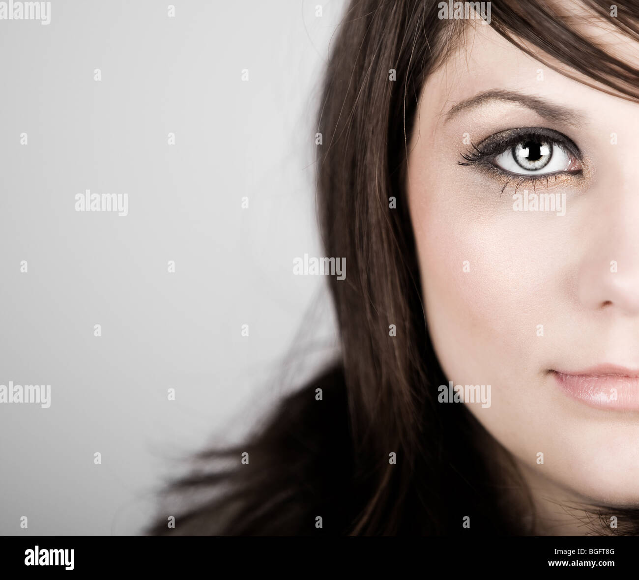 Close Up Shot of a Beautiful Blonde Haired Teenager - Stock Image