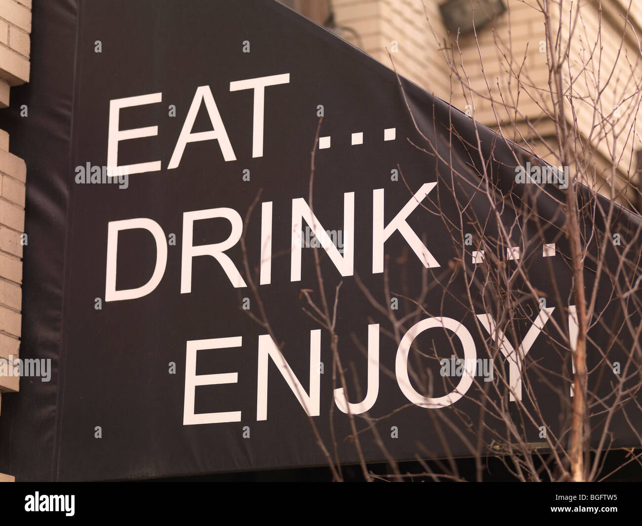 Message on restaurant canopy, Toronto, Ontario, Canada - Stock Image