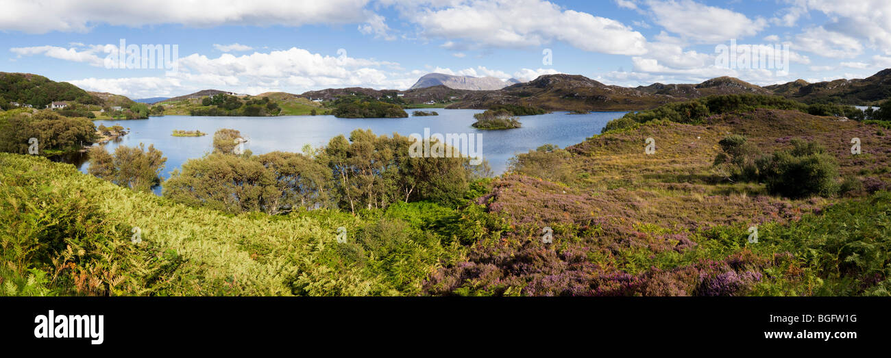 A panoramic view of Loch Drumbeg with Sail Ghorm in the background, Highland, Scotland - Stock Image