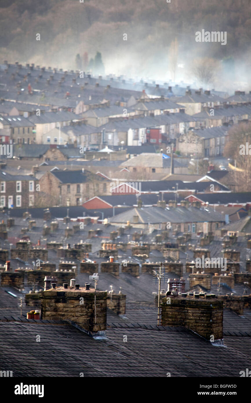 Houses and Chimneys _The industrial rooftops of industrial terraced houses in Accrington, Lancashire - Stock Image