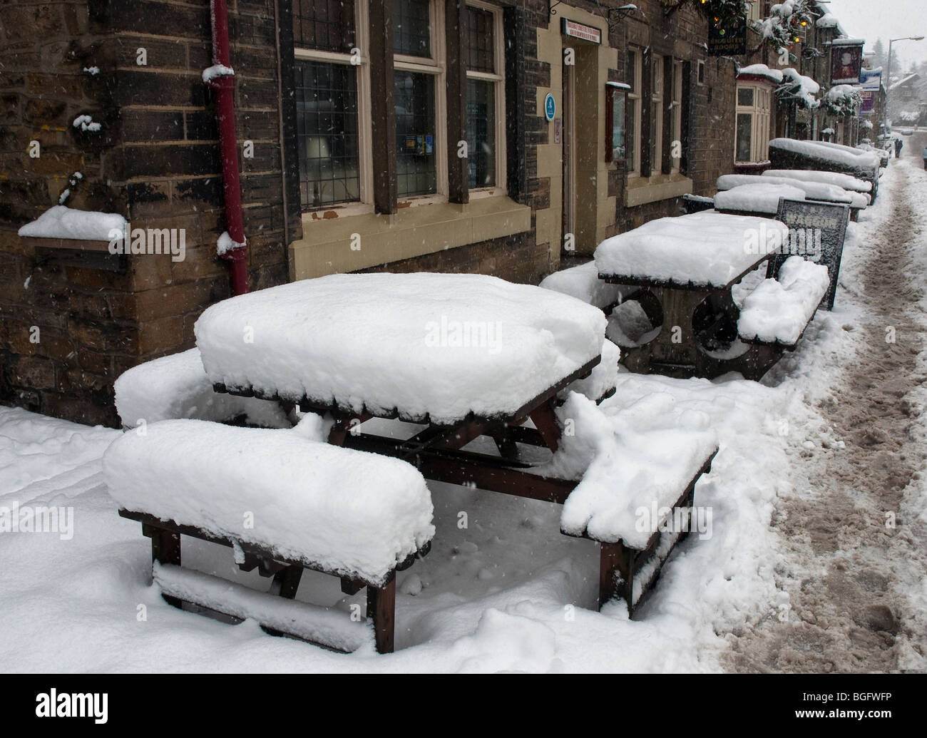 Tables outside Hare and Hounds, Uppermill. Oldham Lancashire UK. - Stock Image