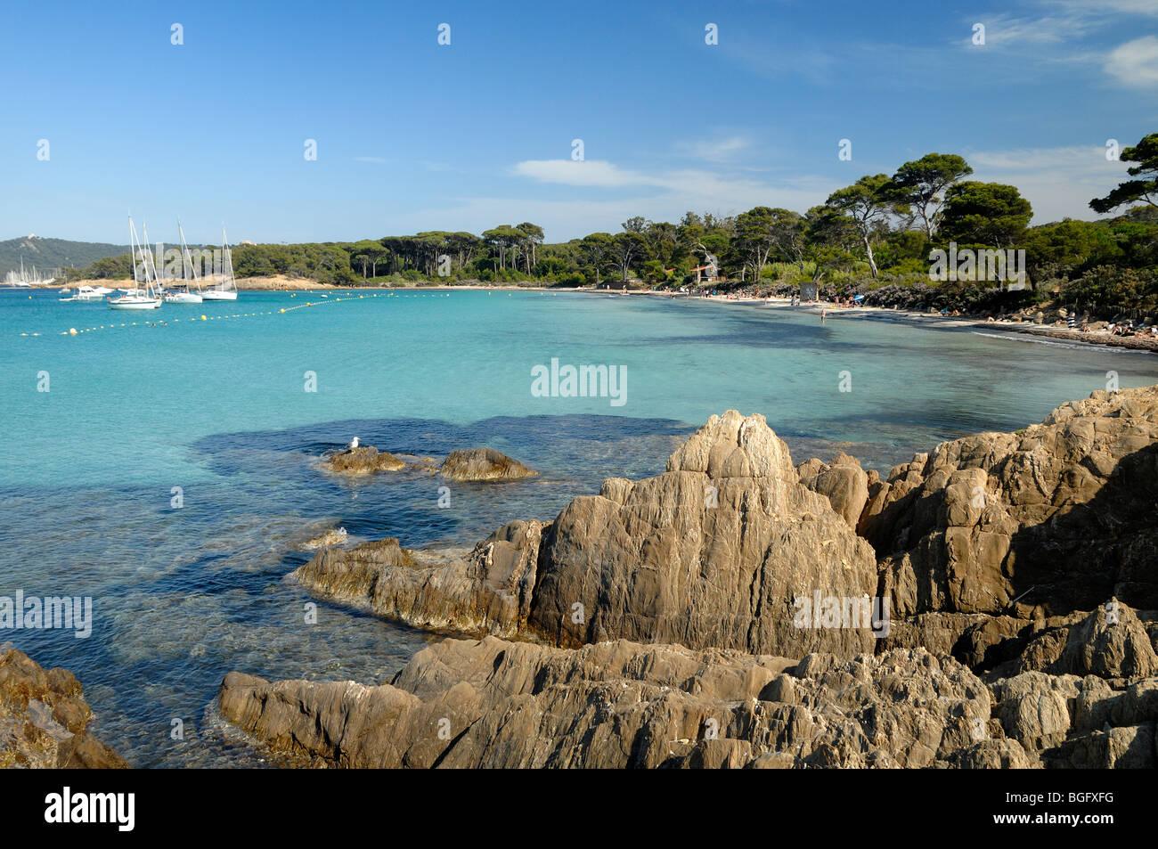 Rocky Seashore of the Plage d'Argent or Beach, Porquerolles Island, Îles Hyères, Var Côte d'Azur - Stock Image