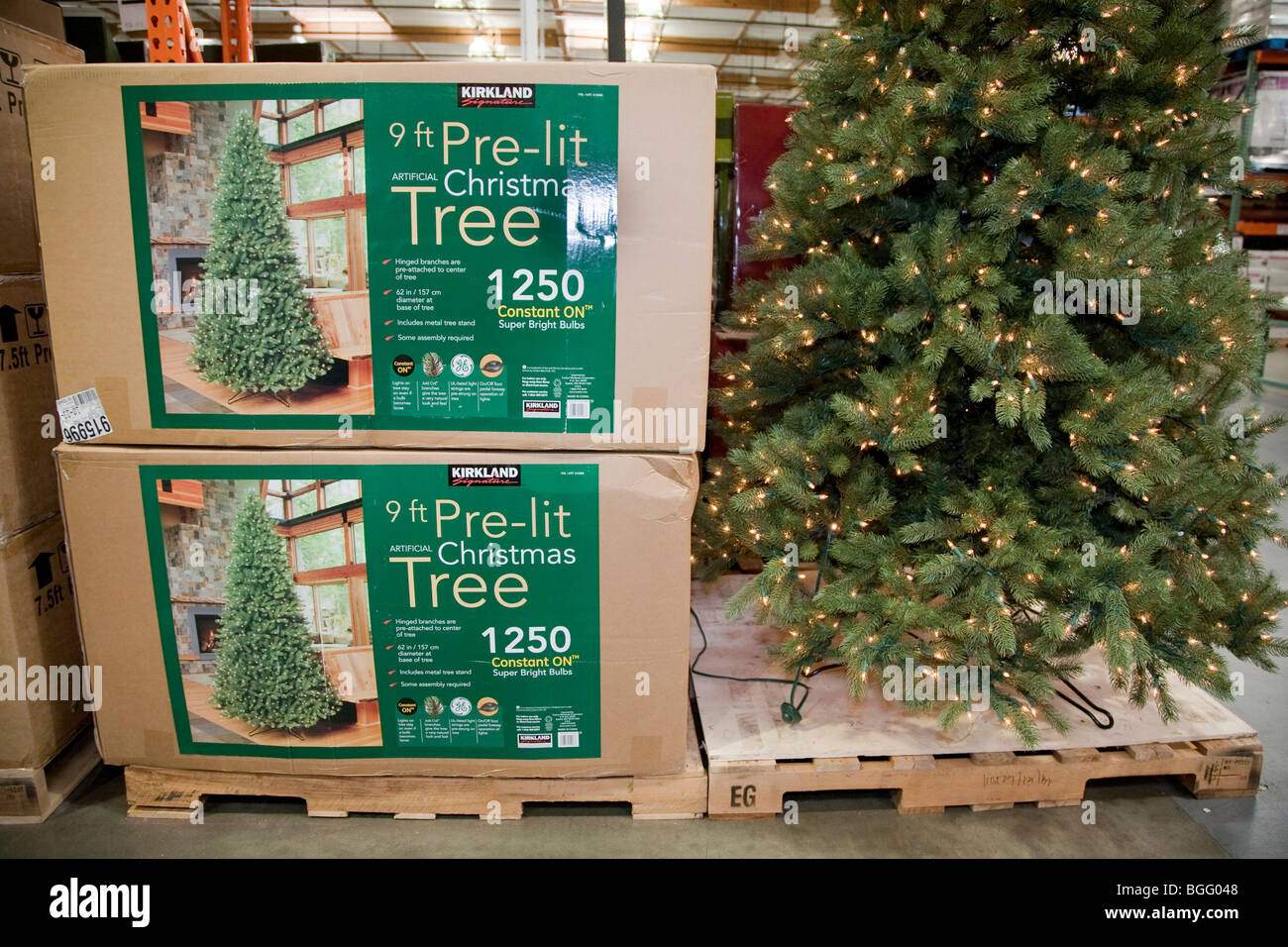 Packages of artificial Christmas tree with lights in store Stock ...