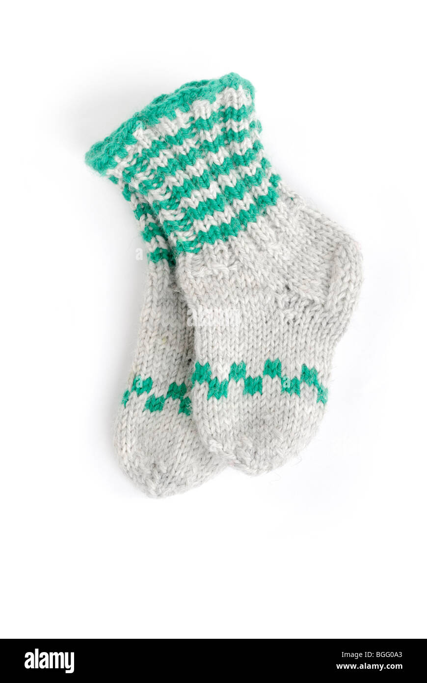 Warm knit wool socks for babies - Stock Image