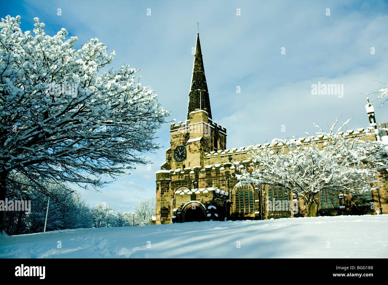 Winwick Church in the Snow. Ian Burton - Stock Image