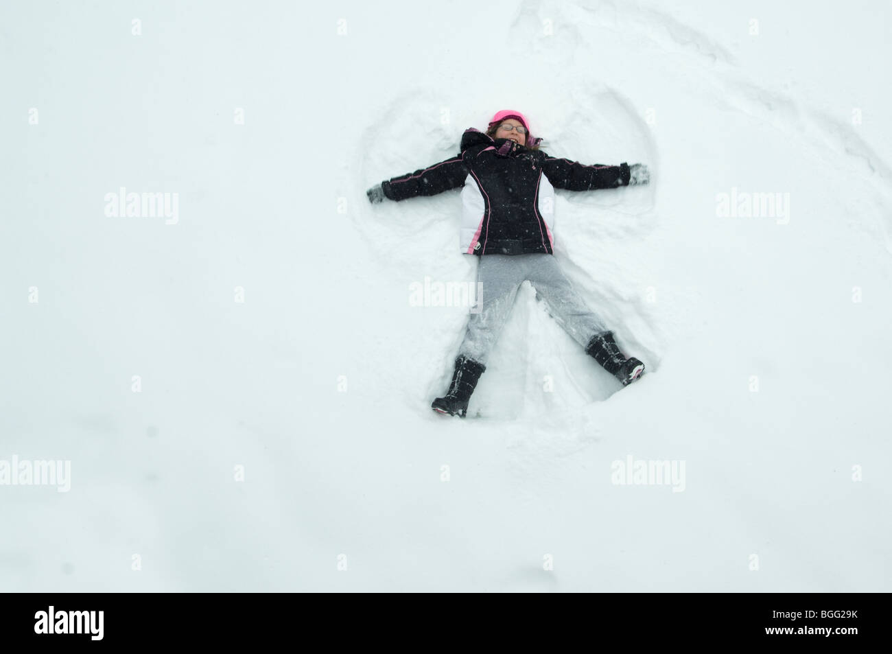 Making a Snow Angel - Stock Image