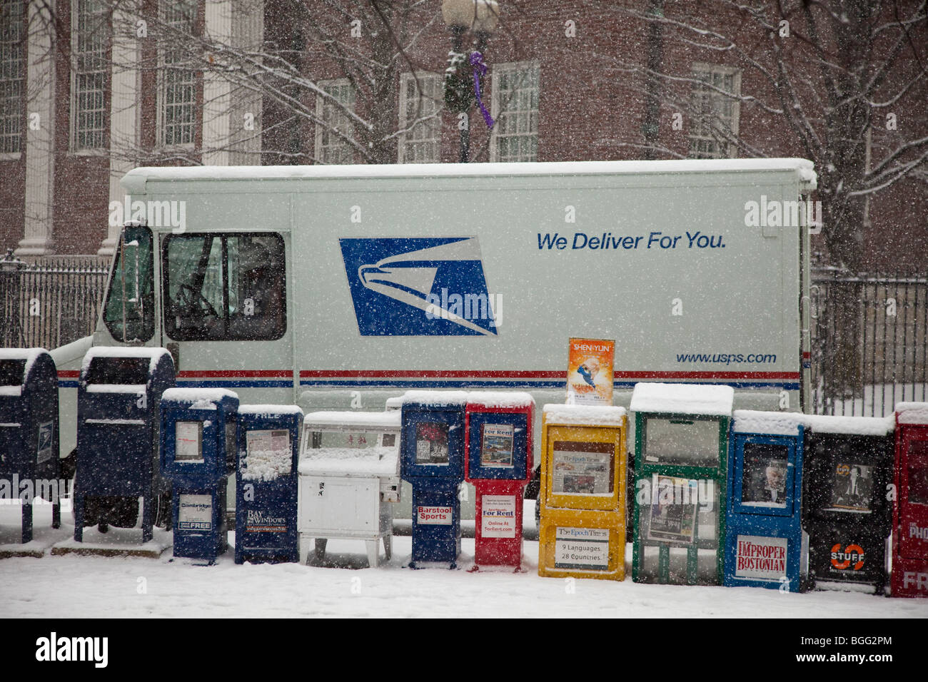 US Postal Service truck during a snowstorm - Stock Image