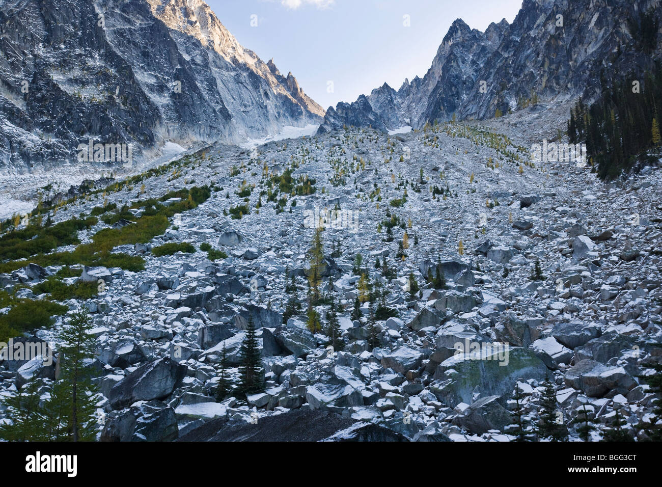 Dragontail Peak and the boulder / talus field above Colchuck Lake covered in an Autumn snow, Washington Cascades, - Stock Image