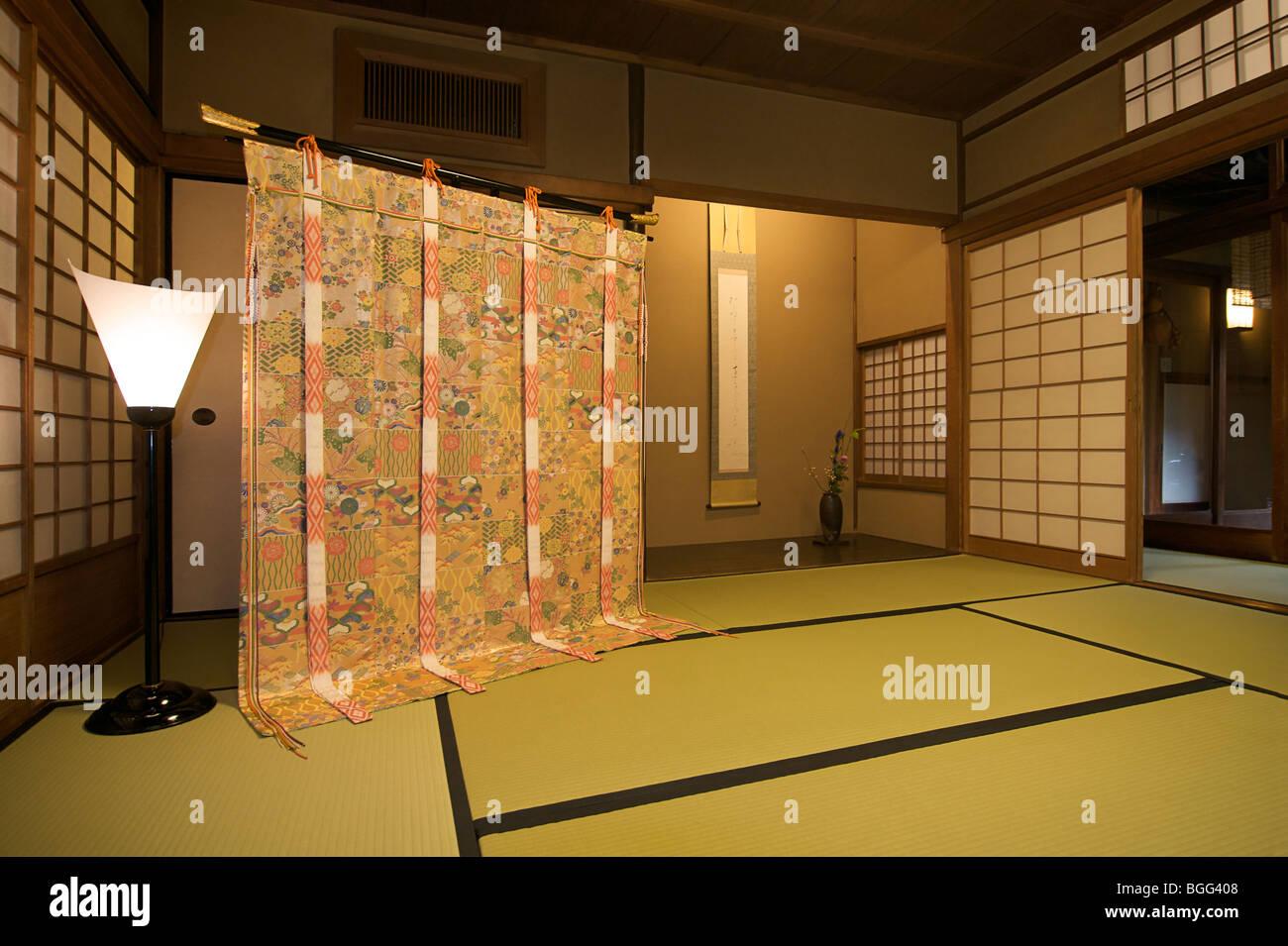 Elaborate kimono fabric displayed at Yoshikawa ryokan, Kyoto, Japan. - Stock Image