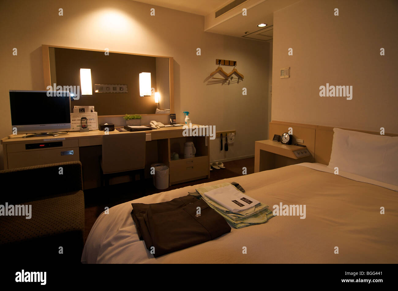 Guests bedroom in the Mitsui Garden Hotel, Kyoto, Japan - Stock Image