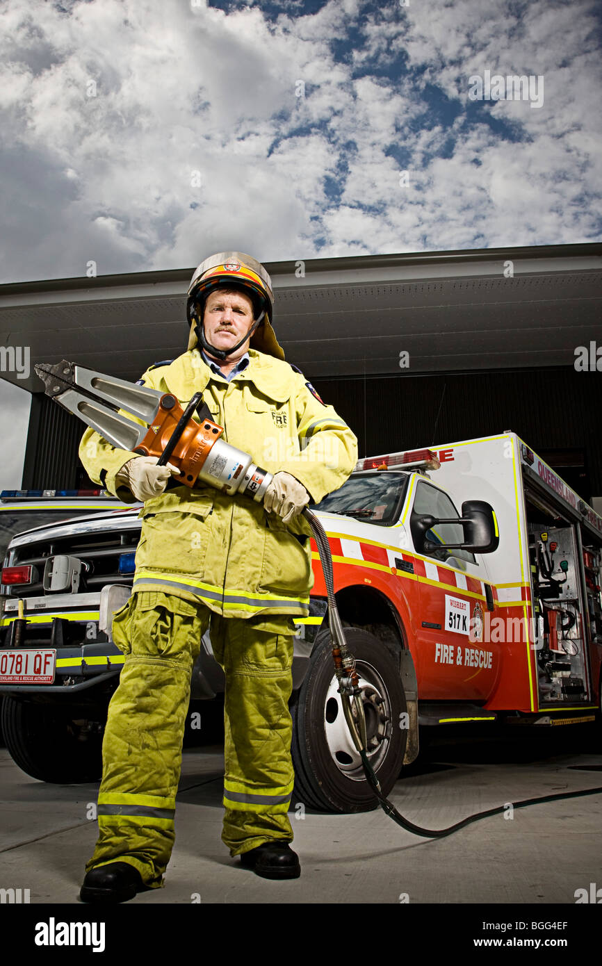 Firefighter holding the 'jaws of life' - Stock Image