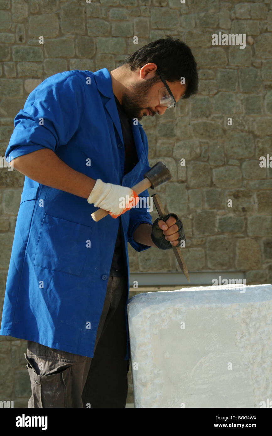 young sculptor working with marble - Stock Image