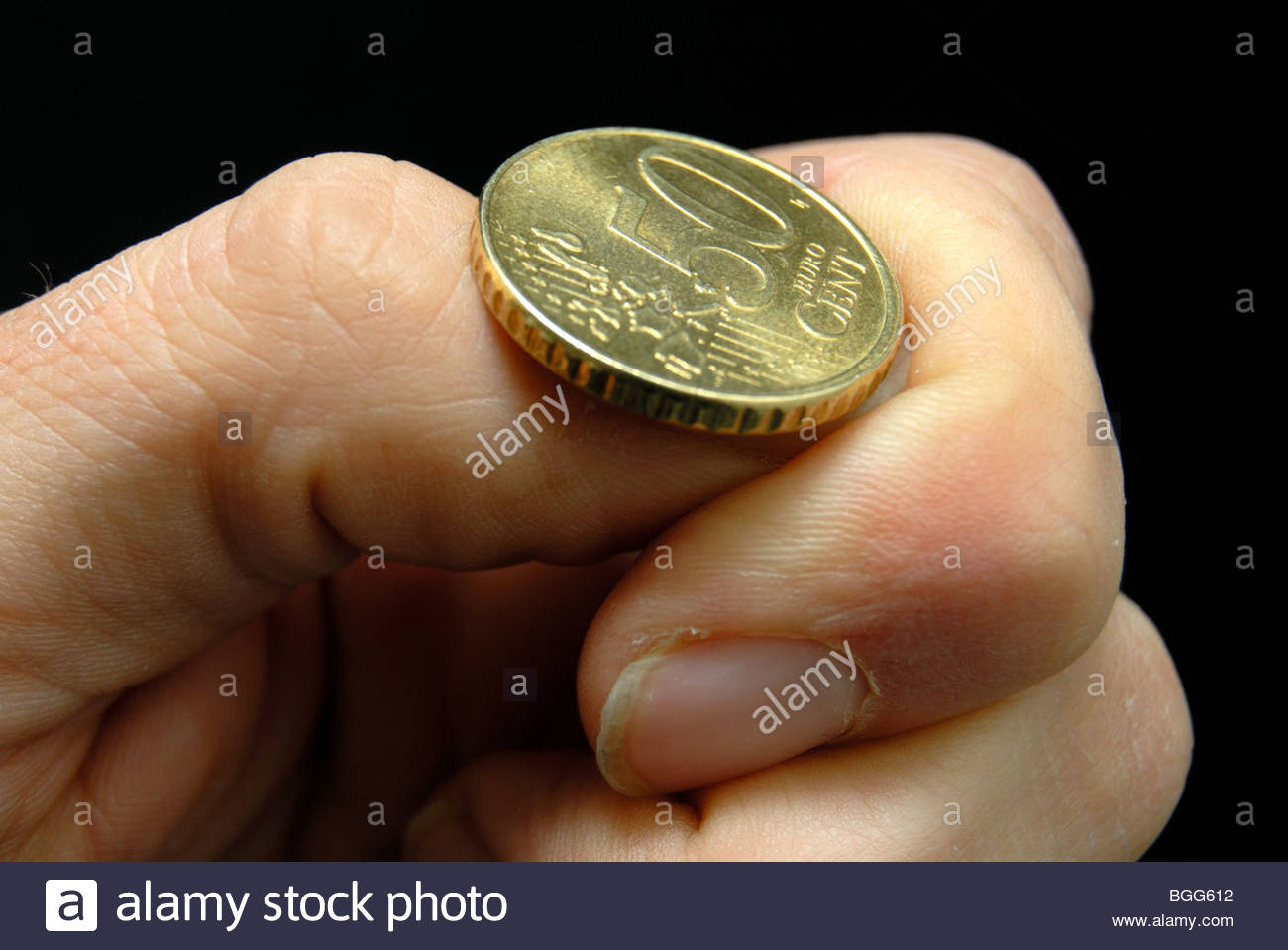 Flipping a Euro 50c coin. - Stock Image