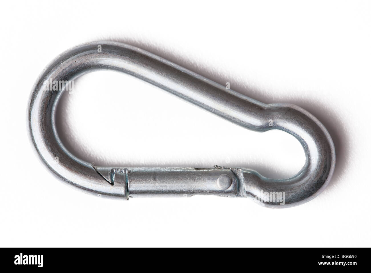 metal climber carabiner on white background - Stock Image