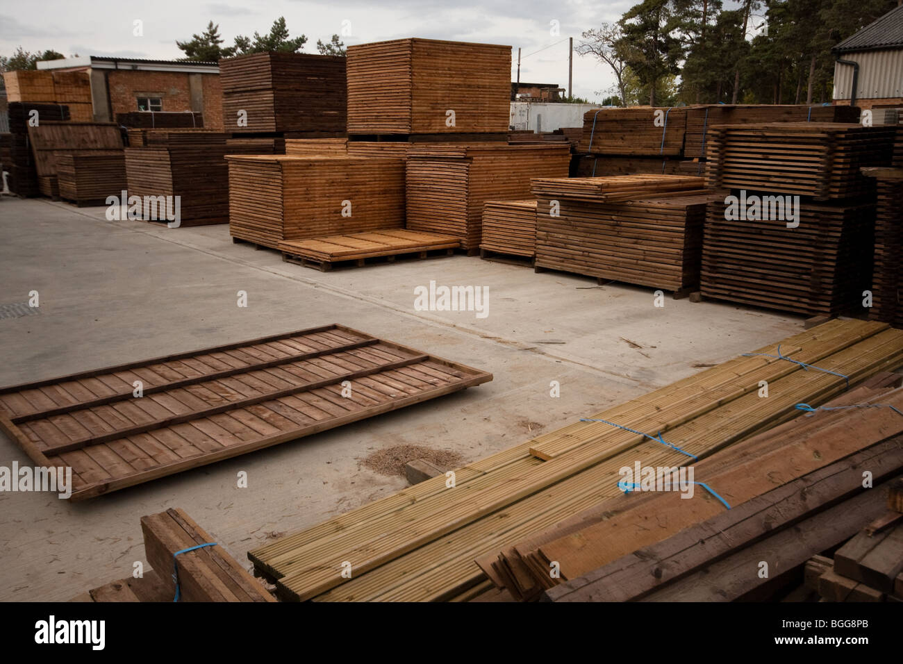 Modern treated wooden fencing in stacks at timber Merchants, England - Stock Image