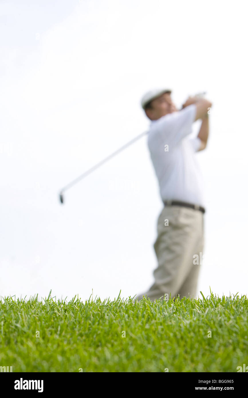 Selective Focus Side View of Golfer's Swing - Stock Image