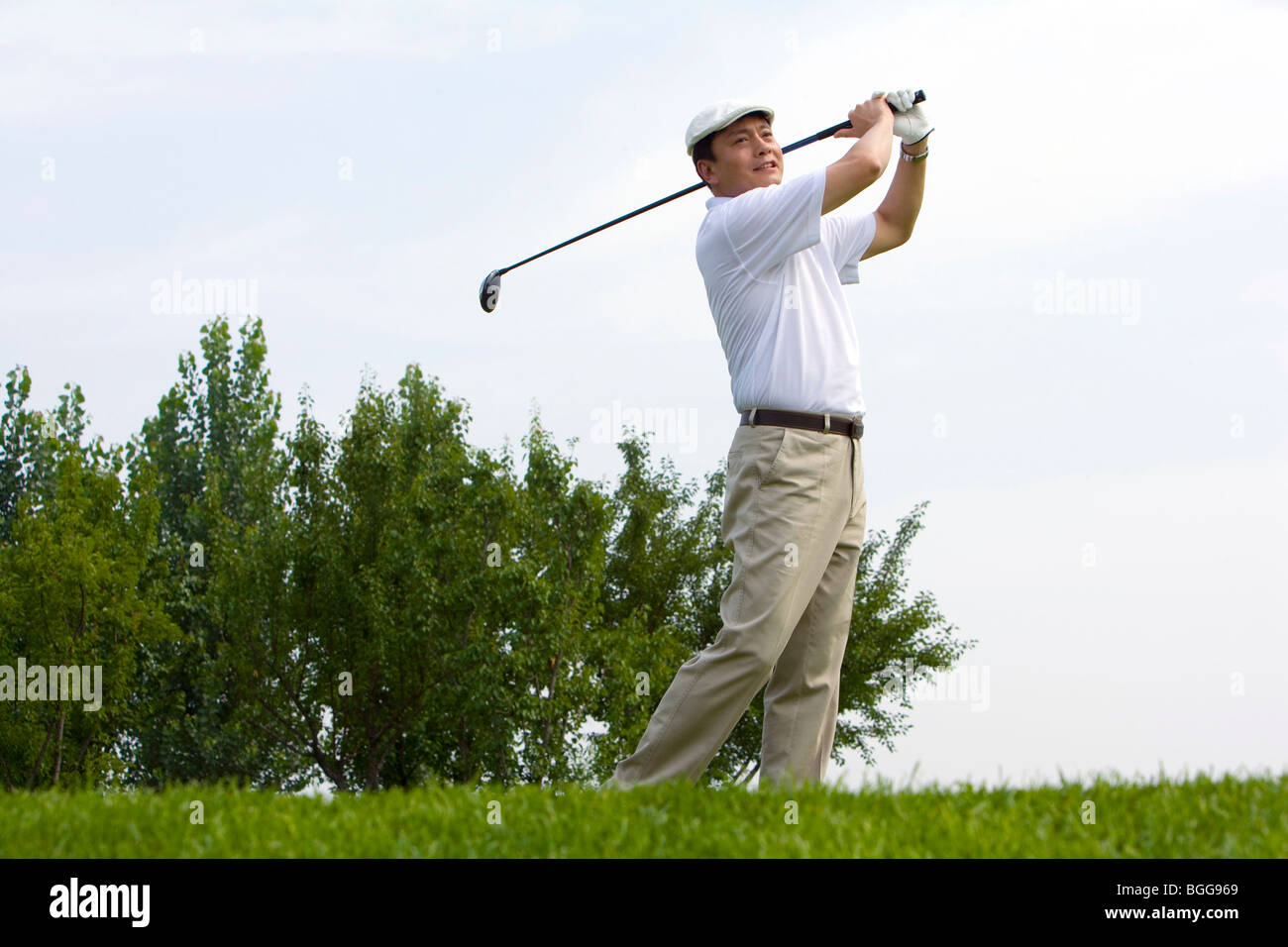 Side View of Golfer's Swing - Stock Image