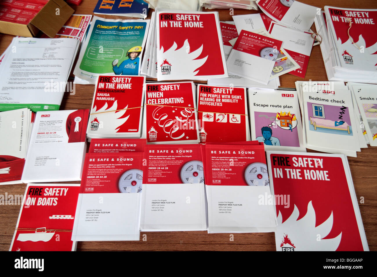A table of Fire Safety leaflets on display at a London Fire Brigade fire safety awareness day, London UK. Dec 2009 - Stock Image