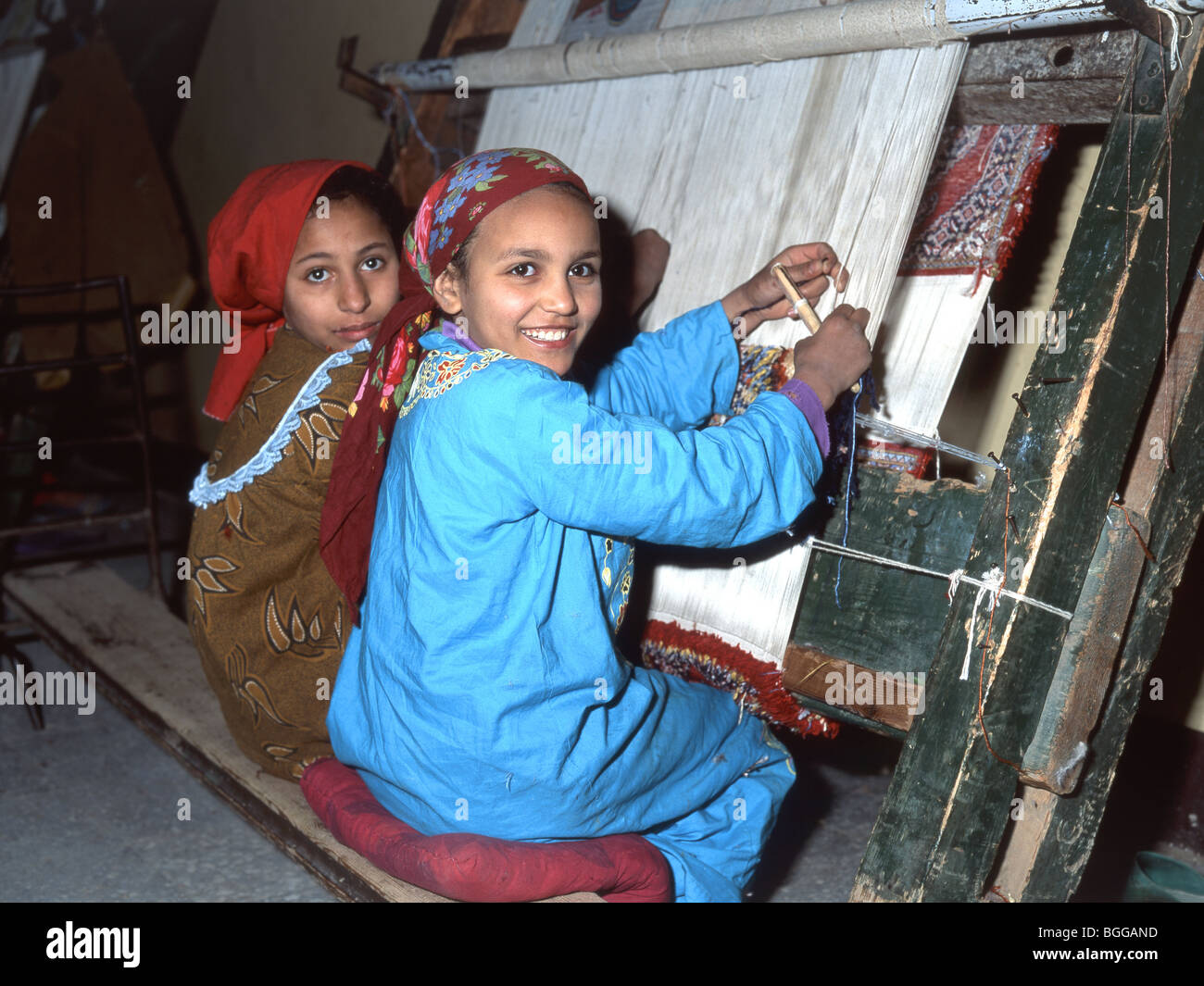 Children working in carpet factory, Cairo, Cairo Governorate, Egypt - Stock Image
