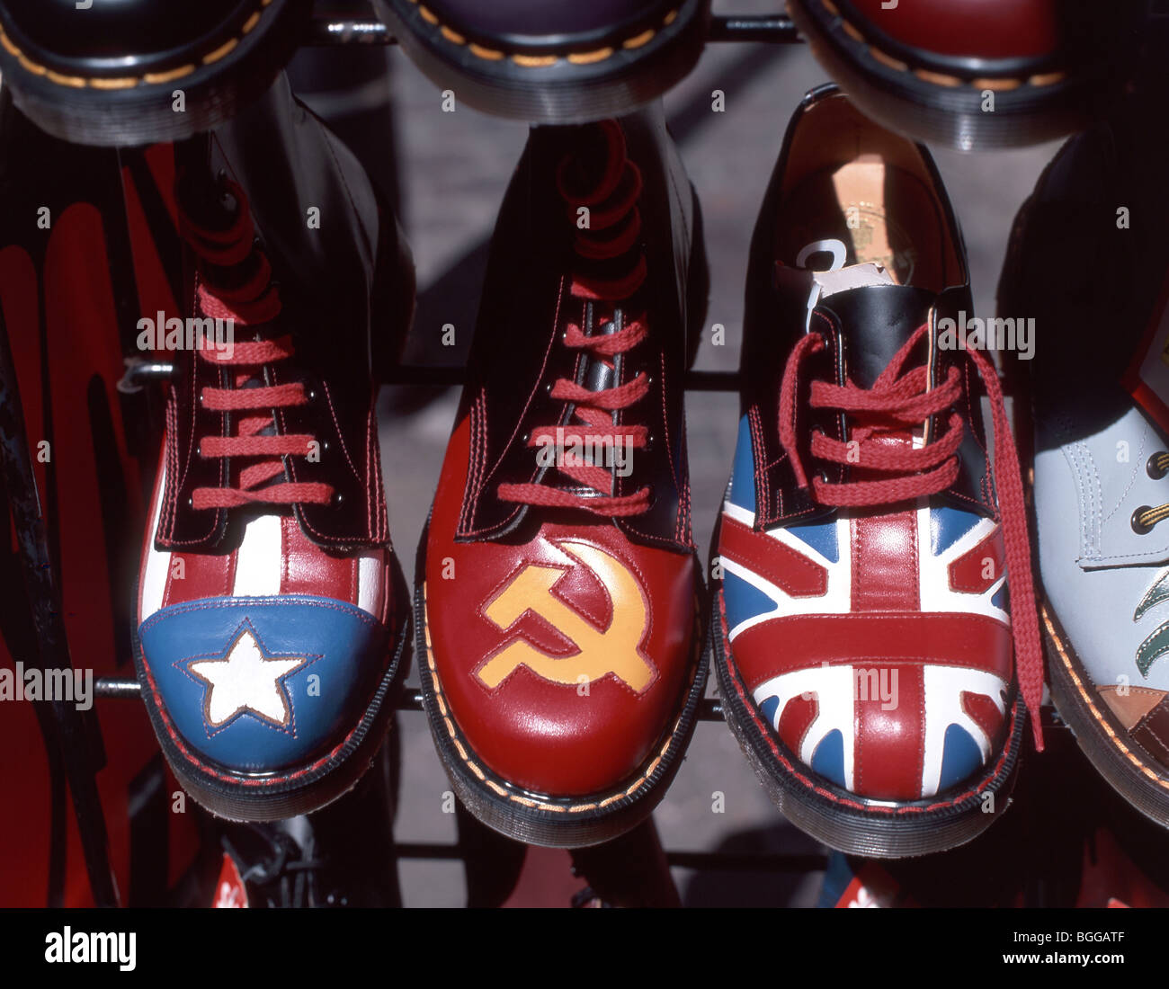 Dr Martens boots with flags, Carnaby Street, Soho District, London, England, United Kingdom - Stock Image
