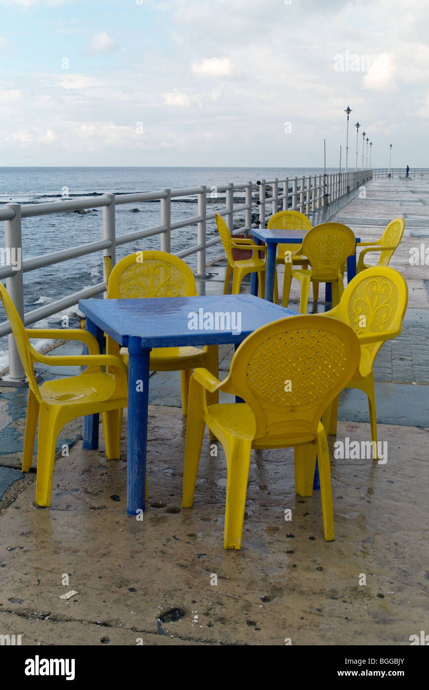deserted plastic tables and chairs along the waterfront at sidon