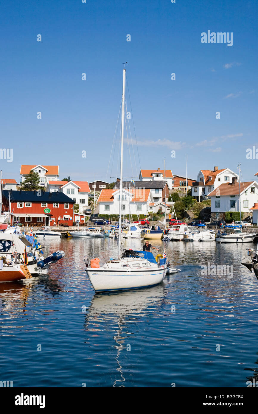 Sailboat on the way out from the port Mollesund in Sweden Stock Photo