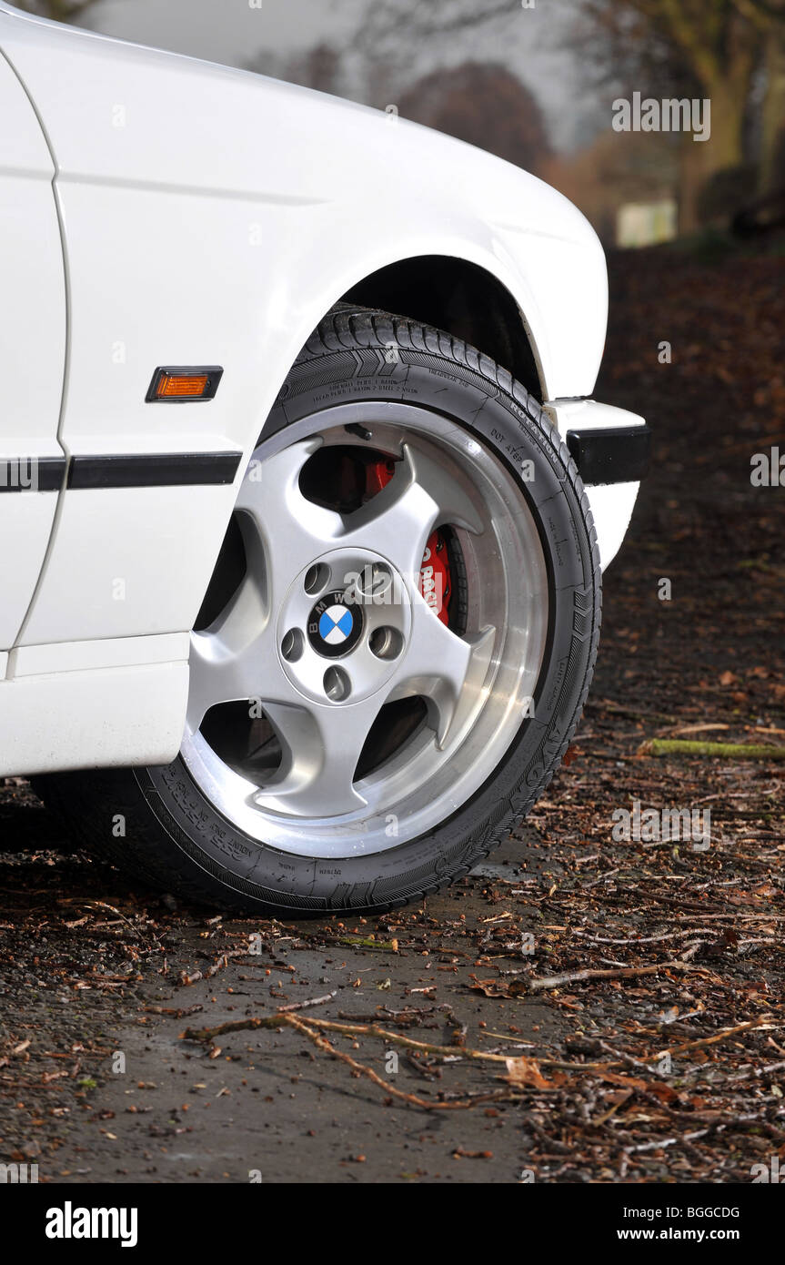 BMW M5 E34 shape in production from 1988 to 1996 front alloy wheel - Stock Image