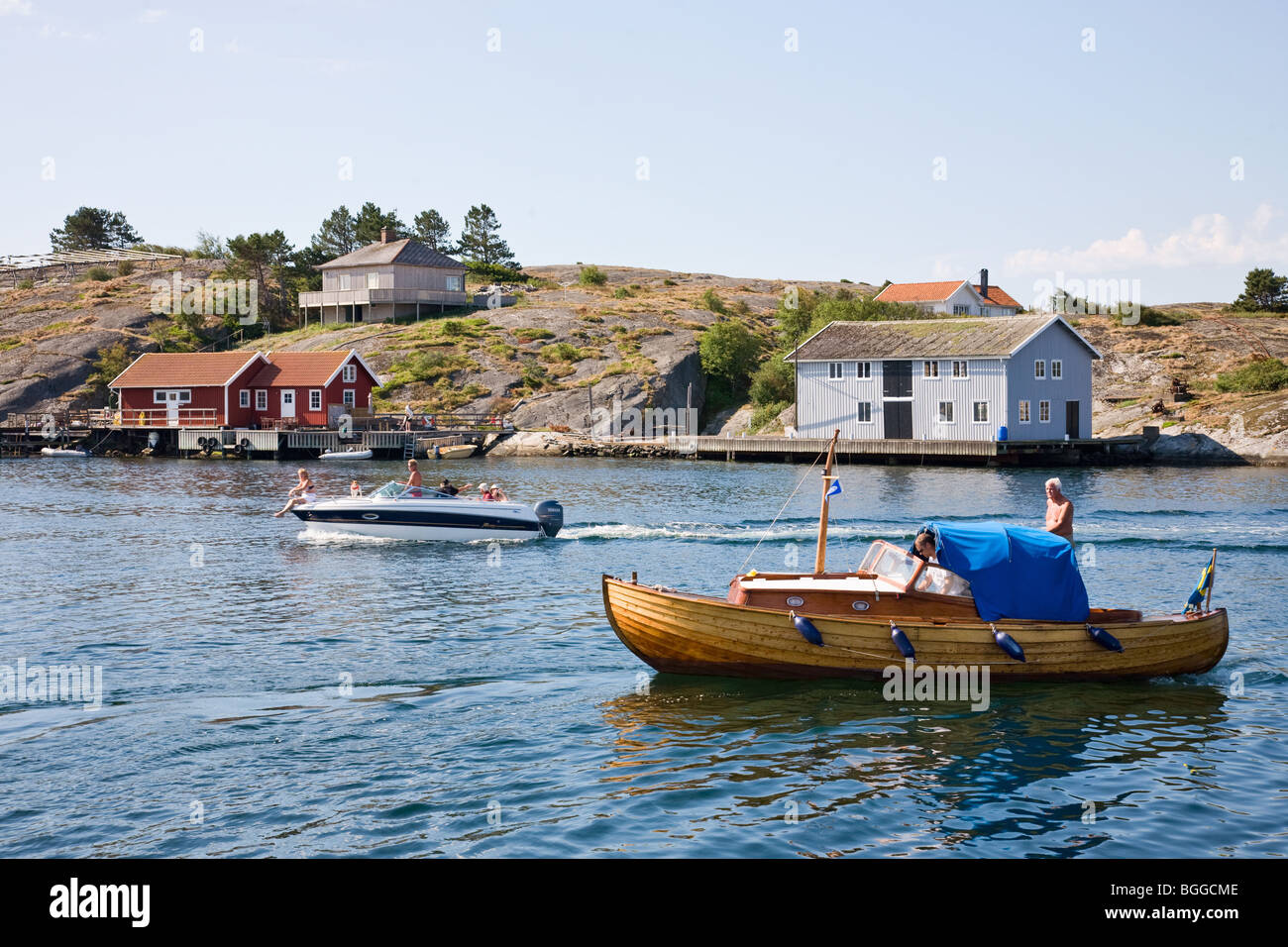 Motorboat on the way into the bay - Stock Image