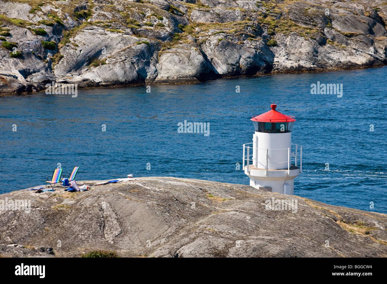 Lighthouse on a rocky coast Stock Photo